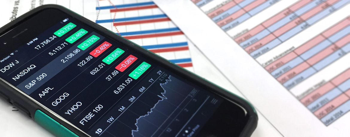 a cell phone shows stock market numbers