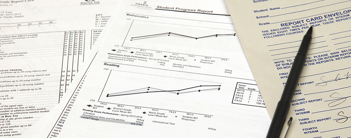 paperwork with charts and graphs