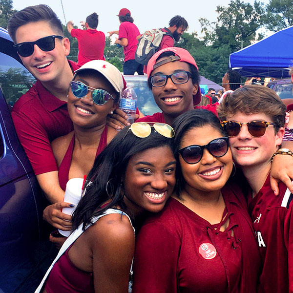 students in gamecock gear at a tailgate