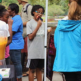 One student indulges in a tasty snack at the Healthy Carolina Farmers' Market.