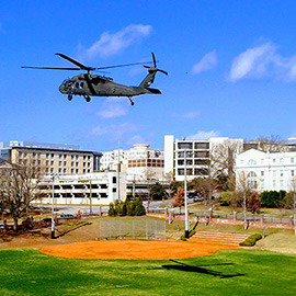Black hawk helicopter over campus on Engineering Day