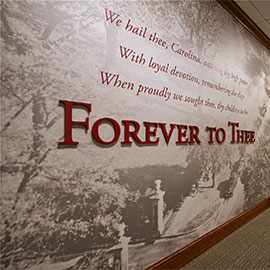 Wall featuring a Forever to Thee mural at Alumni Center