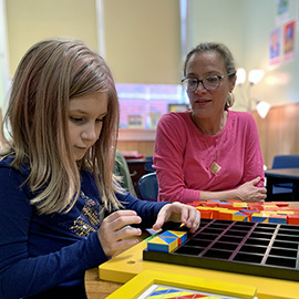 School counselor works with child using play therapy