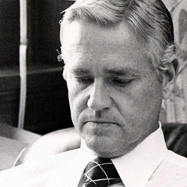 archive photo of hollings reading at desk