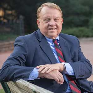 College of Arts and Sciences Dean Lacy Ford sits on a bench