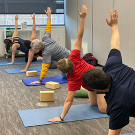 People practicing yoga at the calm oasis space in the health center