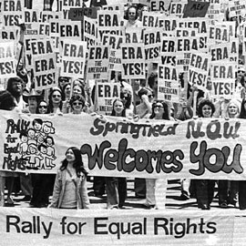 1970s rally of women and men with signs that say ERA Yes