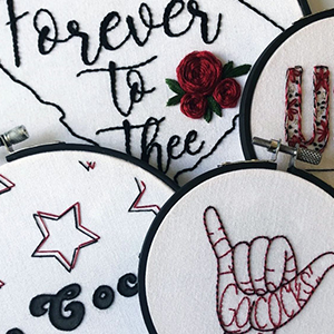 Four of Allison Lambert's UofSC-themed embroidered artworks, from L to R: